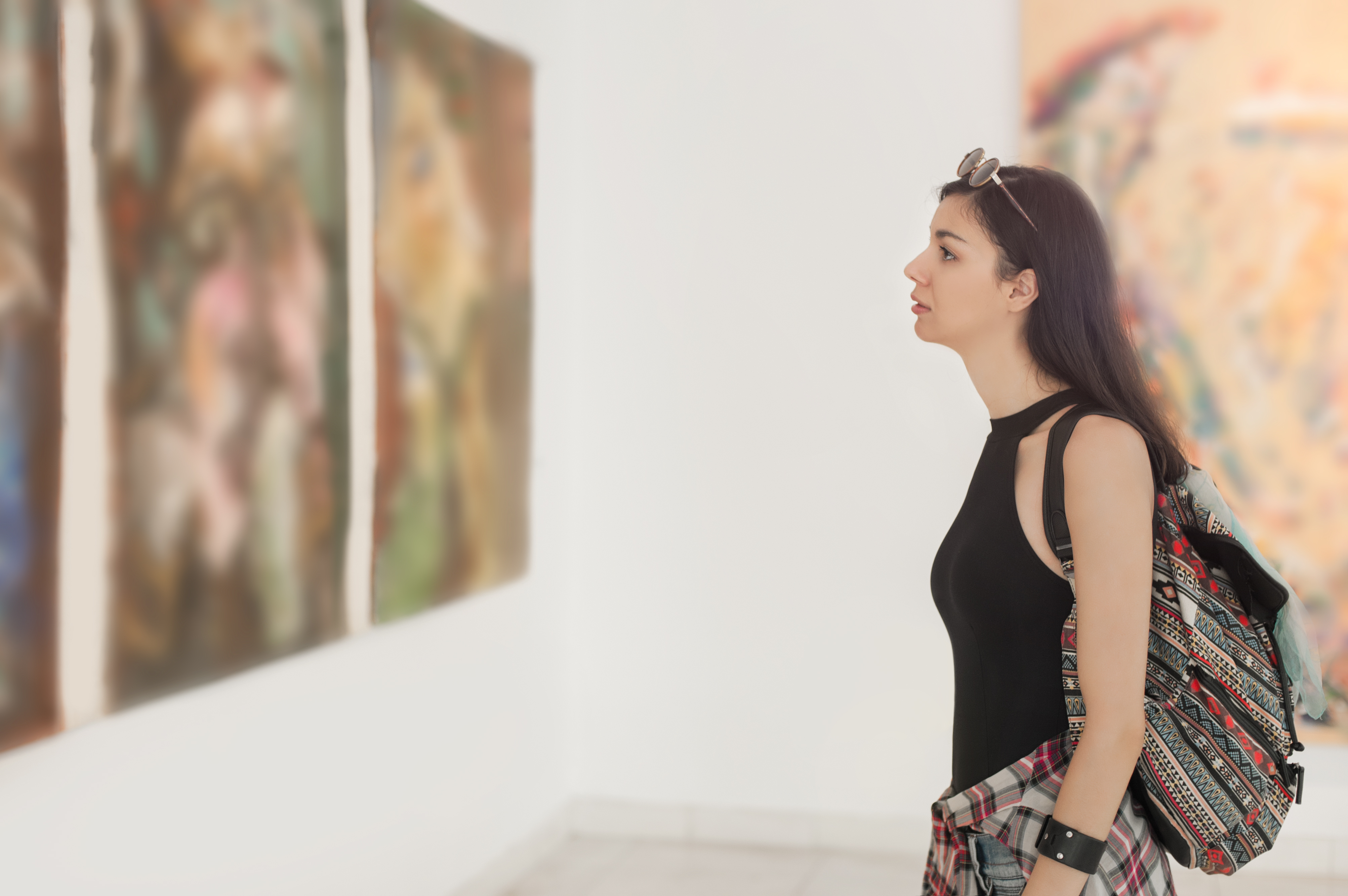 a woman looking at art in a museum