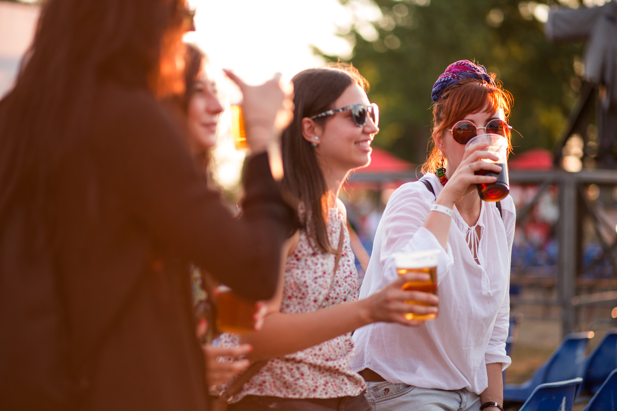 a group of friends tasting beer at one of the festivals near Lone Tree