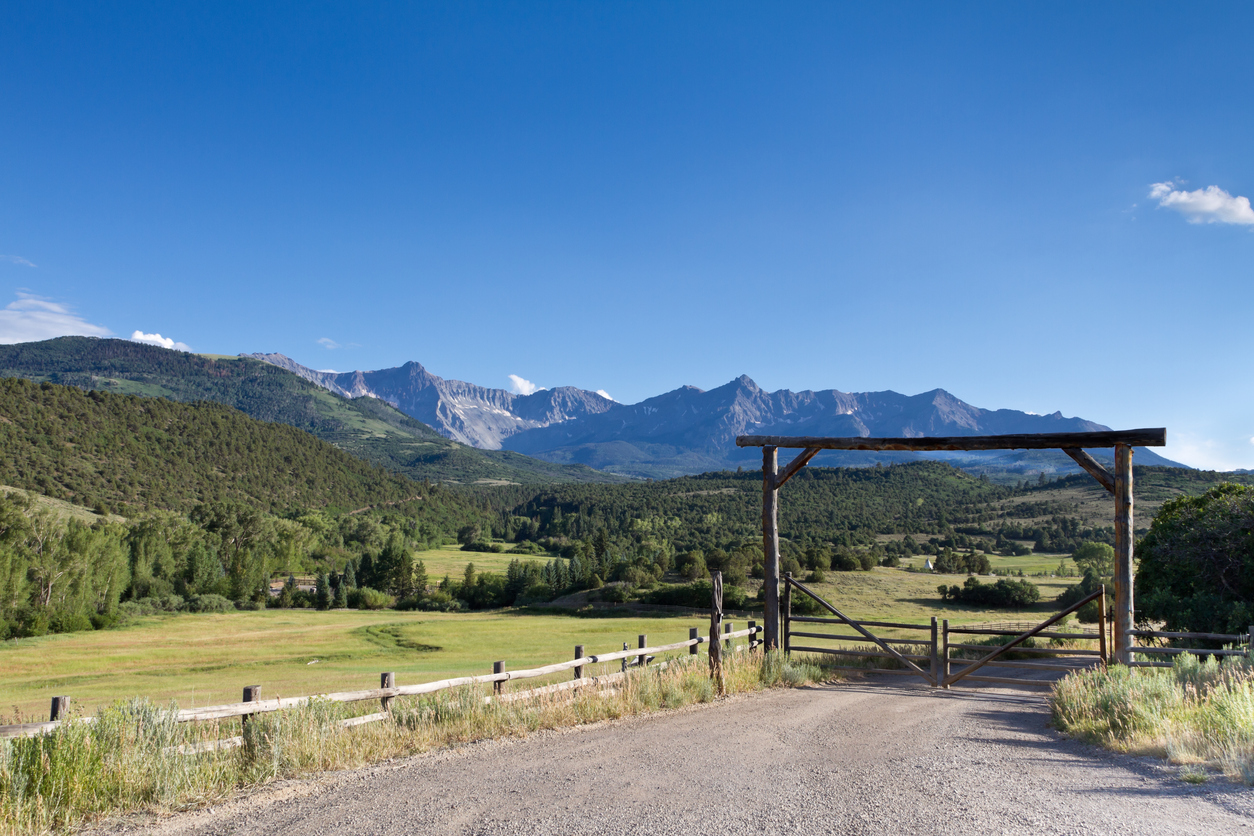 Enterance to Schweiger Ranch with backdrop of Rockies
