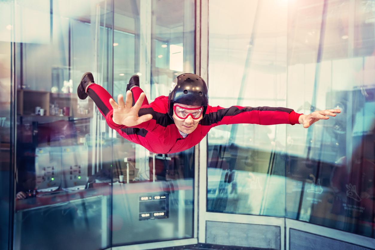 man indoor skydiving