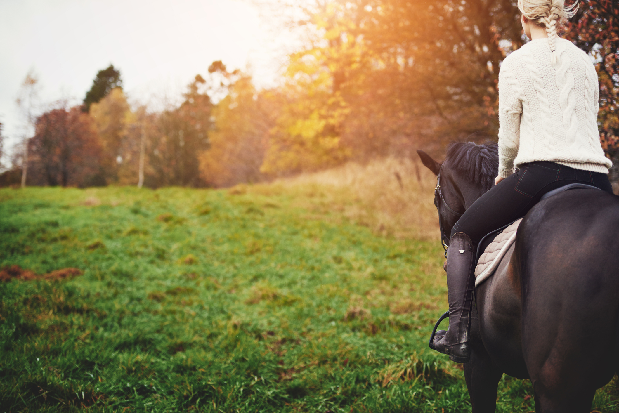 Young woman horseback riding in Lone Tree