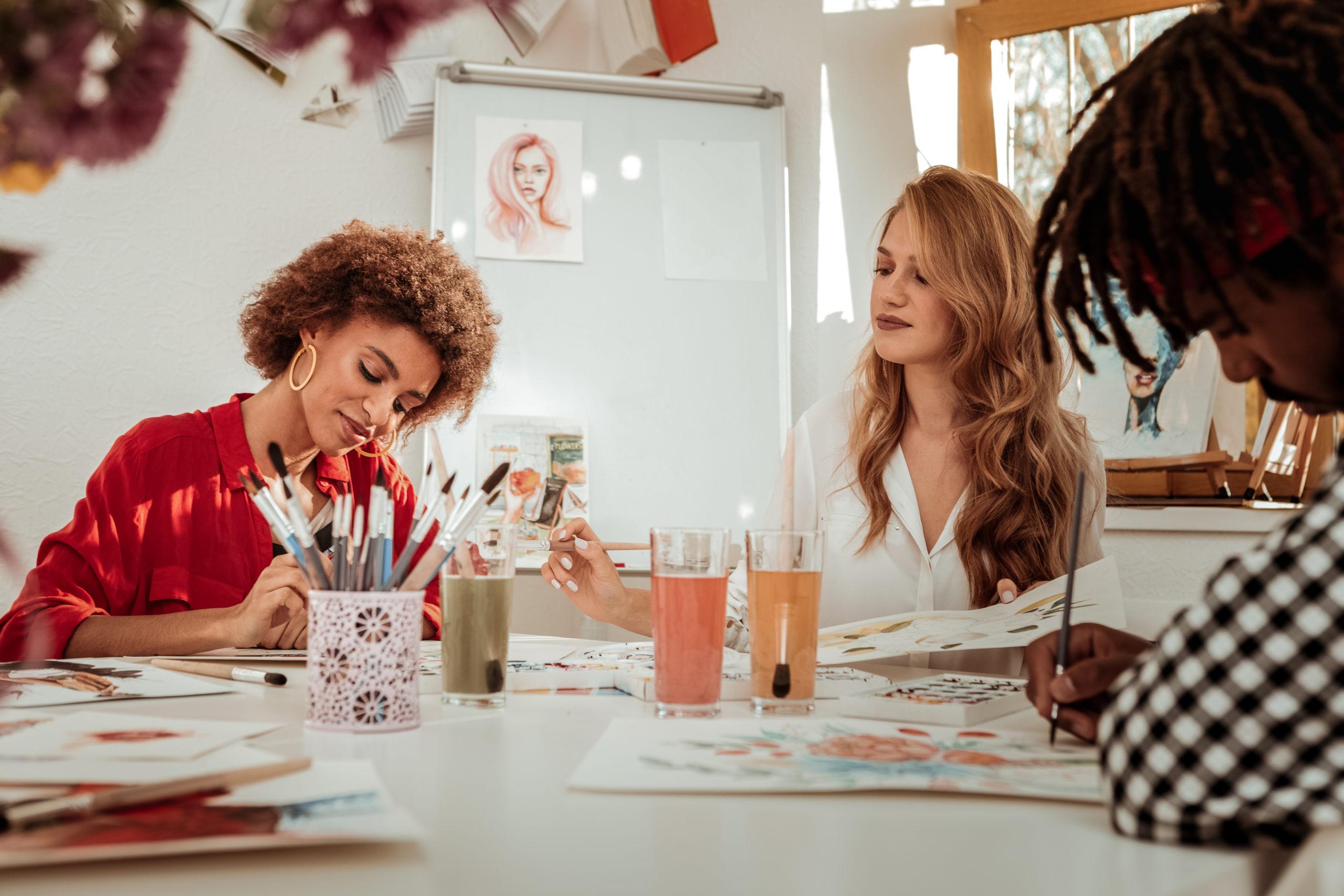 Two women enjoying art classes