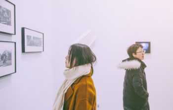 People looking at art on the walls of an art exhibit. Learn More About the Lone Tree Arts Center