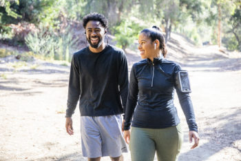 couple hiking along a nature trail