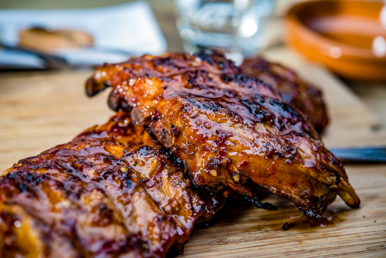 fresh barbecue ribs on a wooden slab
