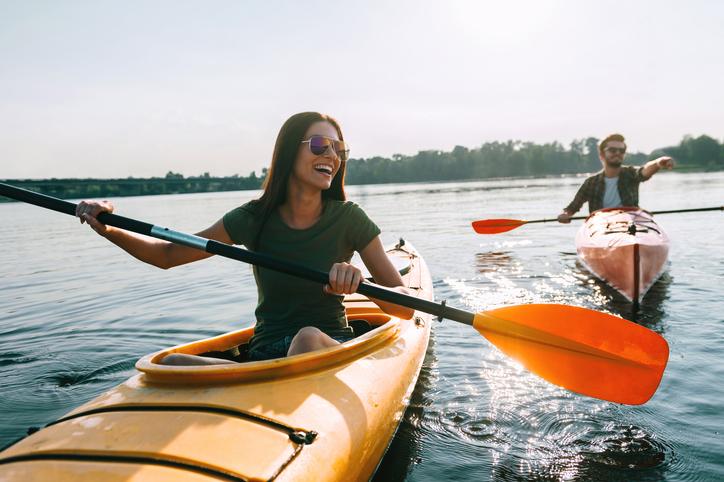 couple kayaking on a lake | paddlesports around Lone Tree